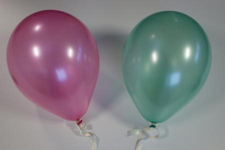 A pink and green balloon