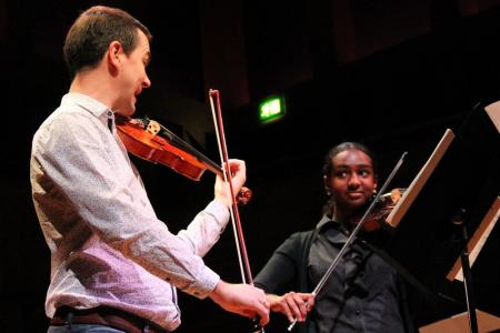 LS player Darragh Morgan performing Berio with a young participant from Kuumba Youth Music