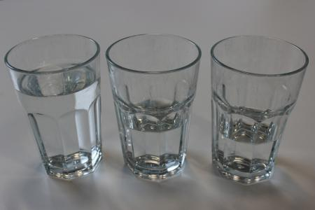 Glasses of water containing different amounts of water