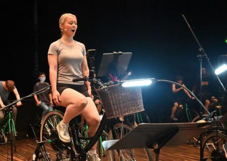Soprano Jessica Aszodi in cycle-powered concert Houses Slide